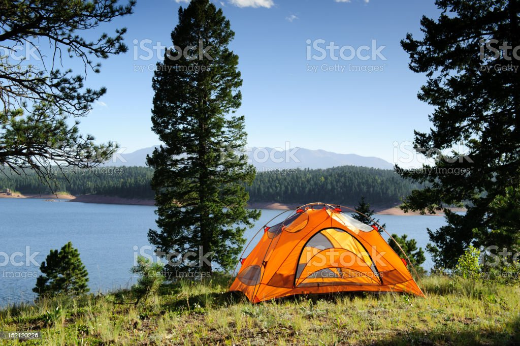 Camping Tent by Mountain Lake royalty-free stock photo
