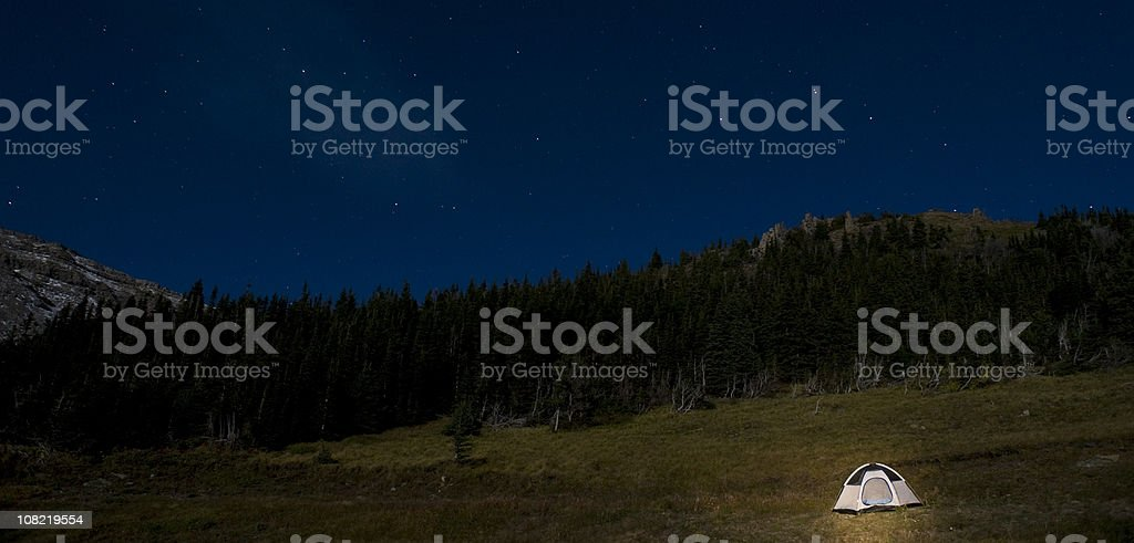 Camping Tent in Field at Night royalty-free stock photo