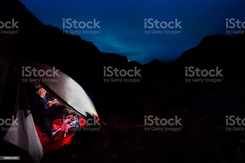 Camping under Aurora Borealis stock photo