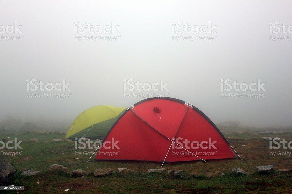 camping under fog stock photo