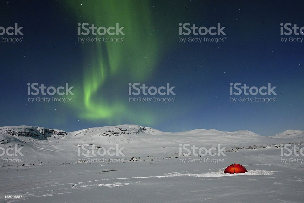 camping under northern lights royalty-free stock photo