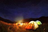 Camping under the stars at night