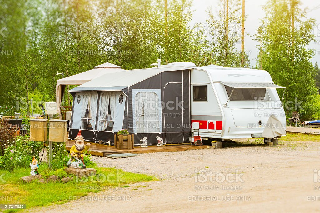 Camping vans and tents on a green meadow. Purhon Campsite stock photo
