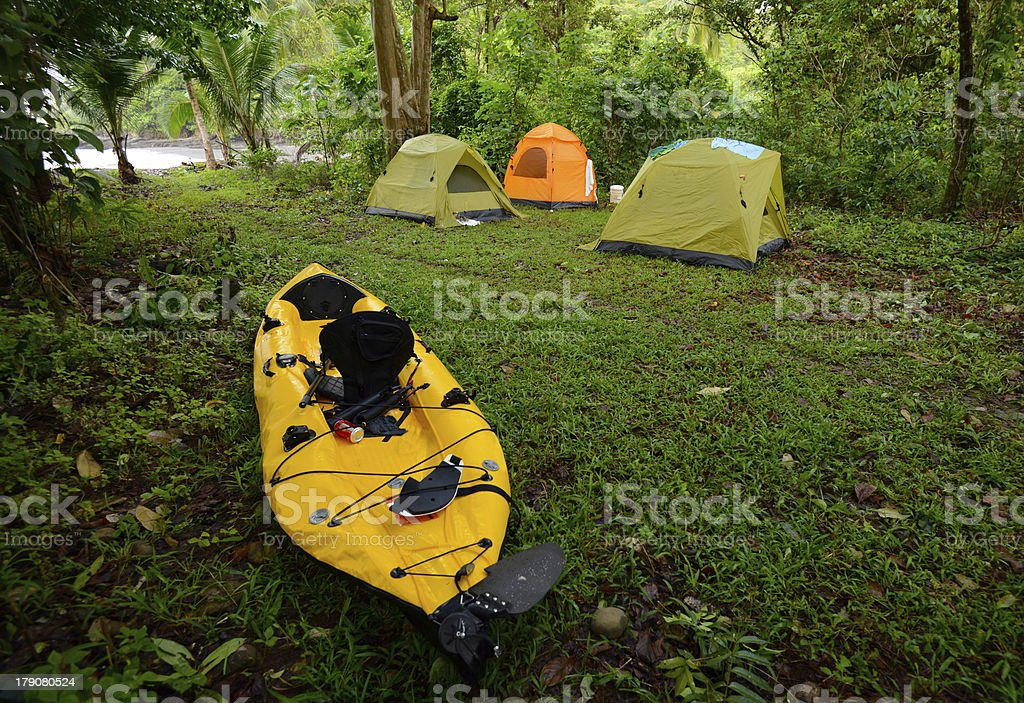 camping with tents and a kayak near ocean royalty-free stock photo