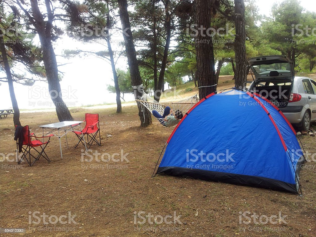 Camping woman with hommack and tent stock photo