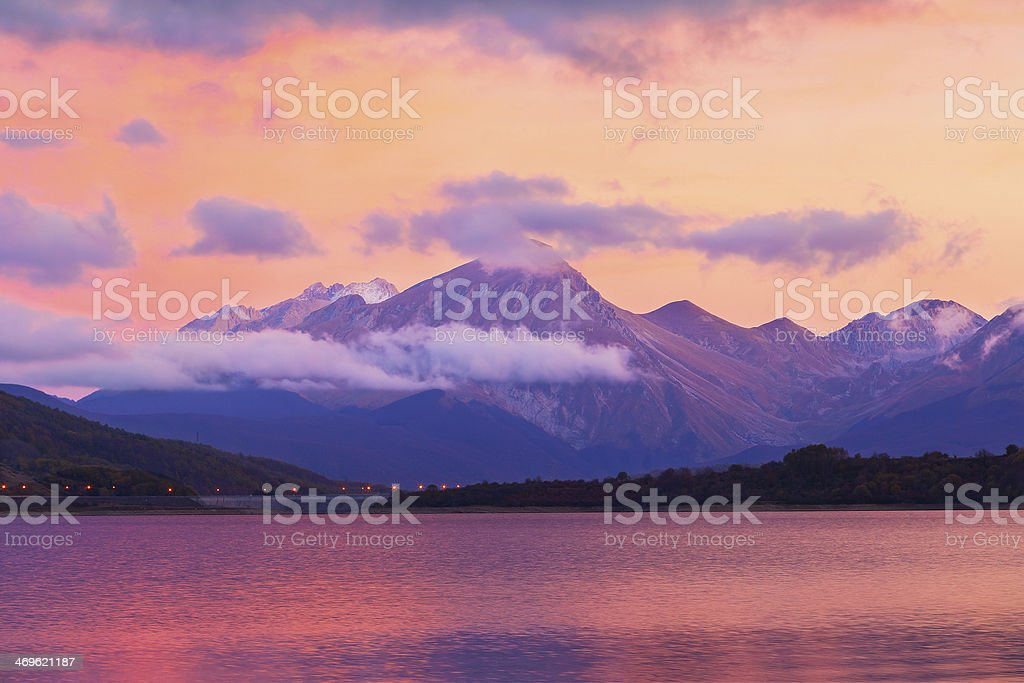 campotosto lake sunset stock photo