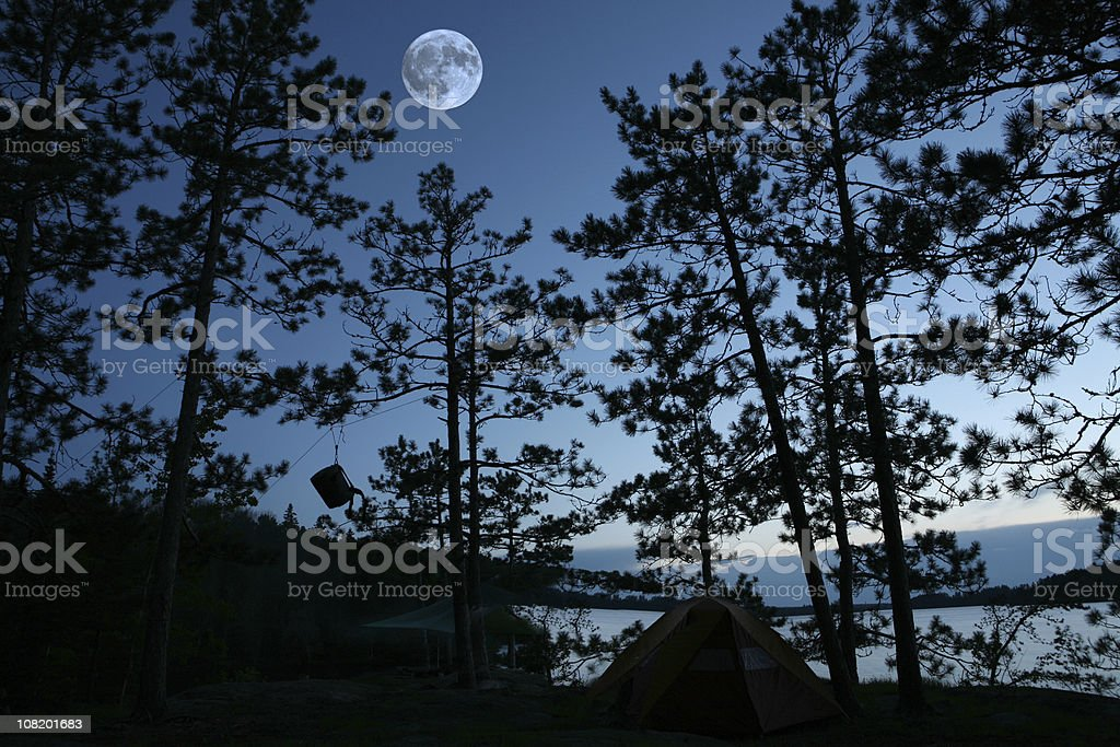 Campsite at Night with Full Moon and Bear Rope royalty-free stock photo