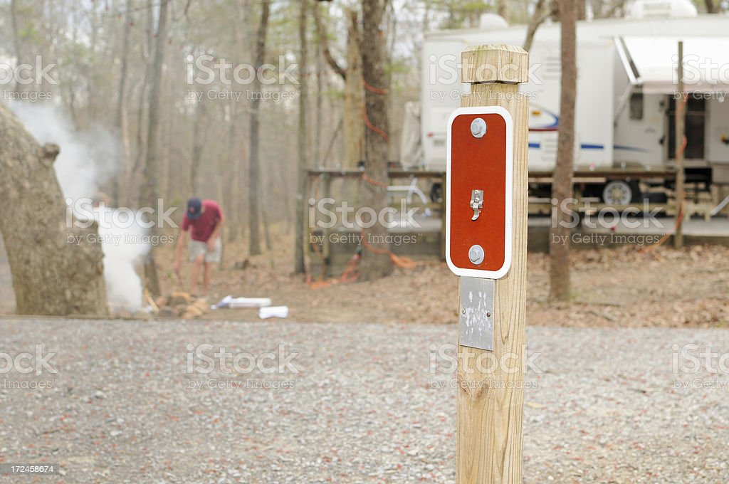 Campsite with campfire by kids royalty-free stock photo