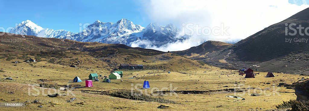Campsite with tents on the top of high mountains royalty-free stock photo
