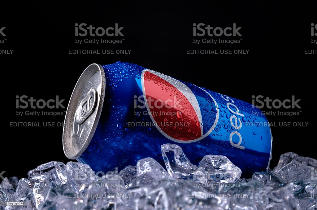 Can and glass of Pepsi cola stock photo
