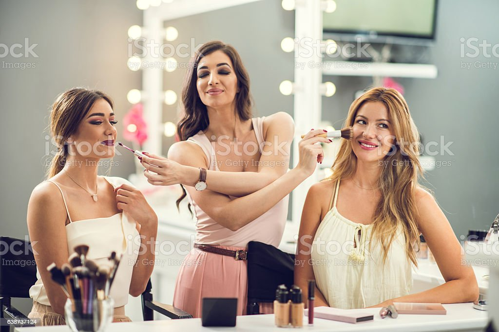 I can do your make-up with my eyes closed! stock photo
