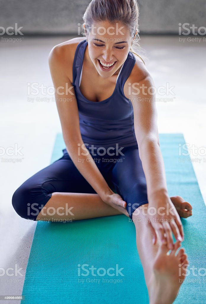 I can finally touch my toes! stock photo
