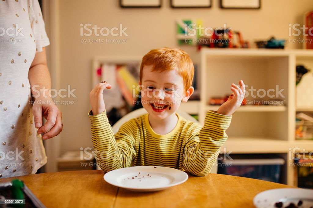 Can I have another slice, Mum? stock photo