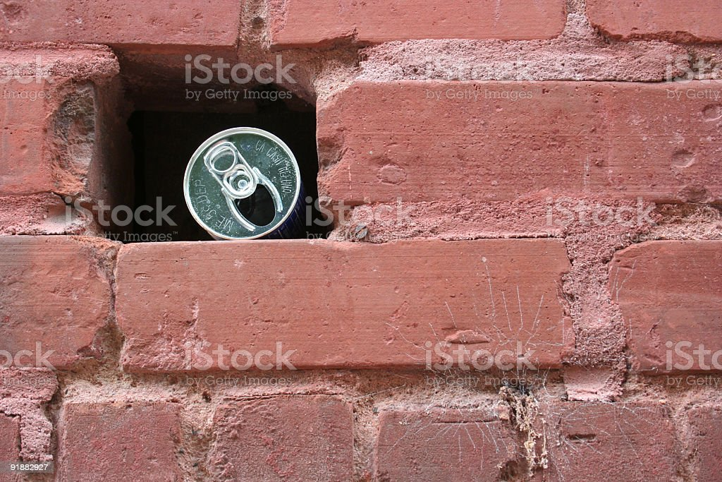 Can in a Brick Wall royalty-free stock photo