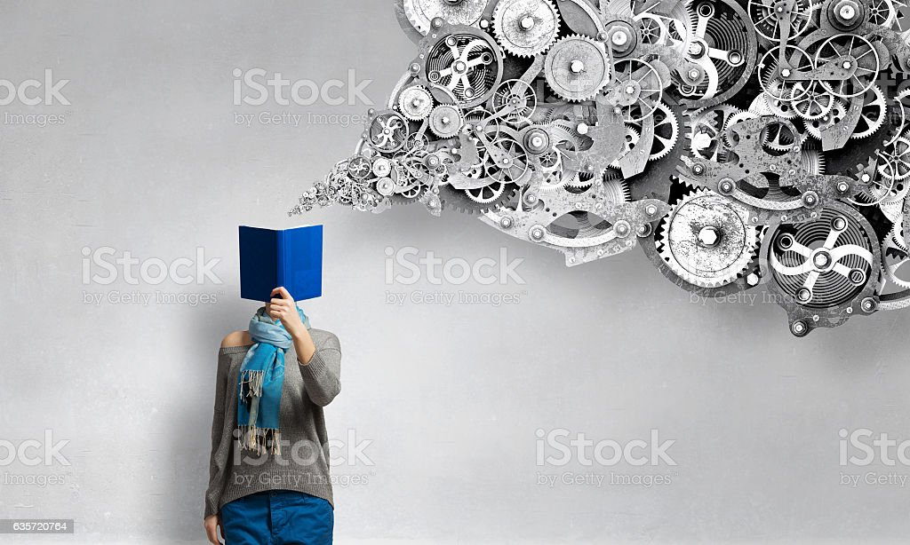 Can not take her eyes off the book . Mixed media stock photo