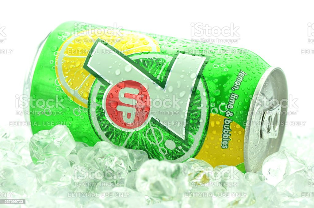 Can of 7 Up drink on ice isolated on white stock photo