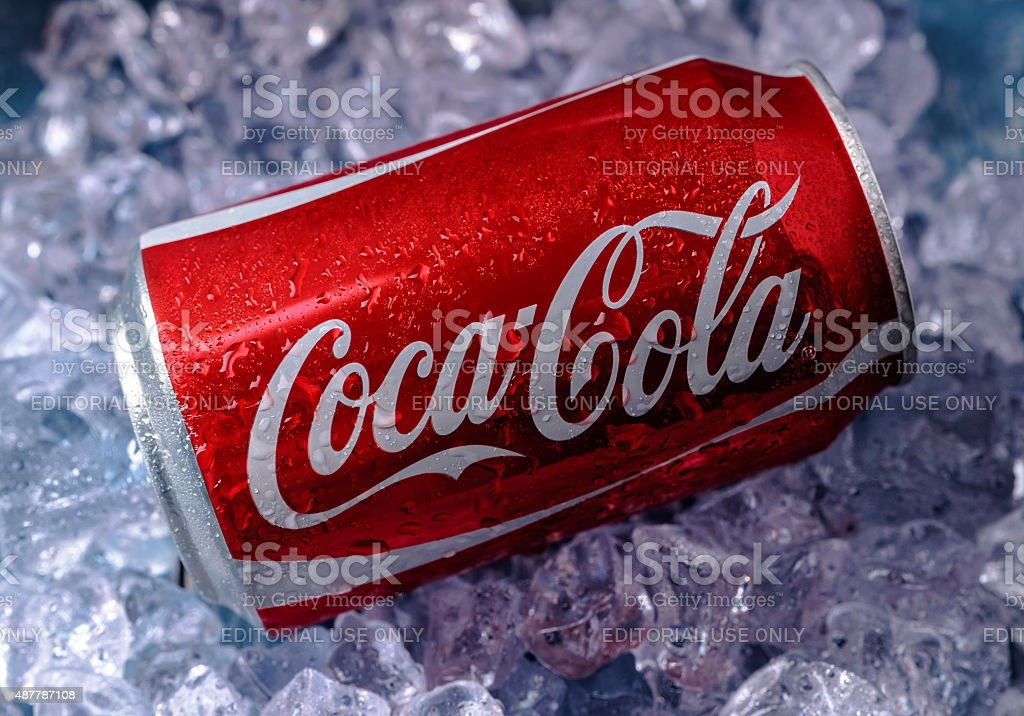 Can of Coca-Cola on ice stock photo