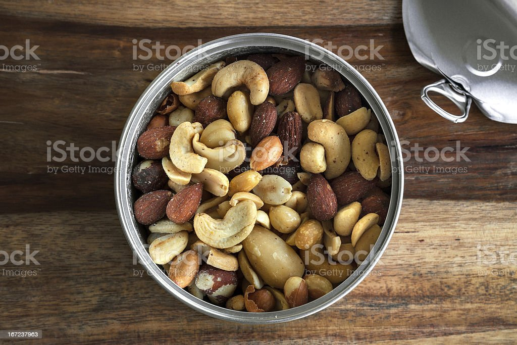 Can of healthy nuts over a cutting table stock photo