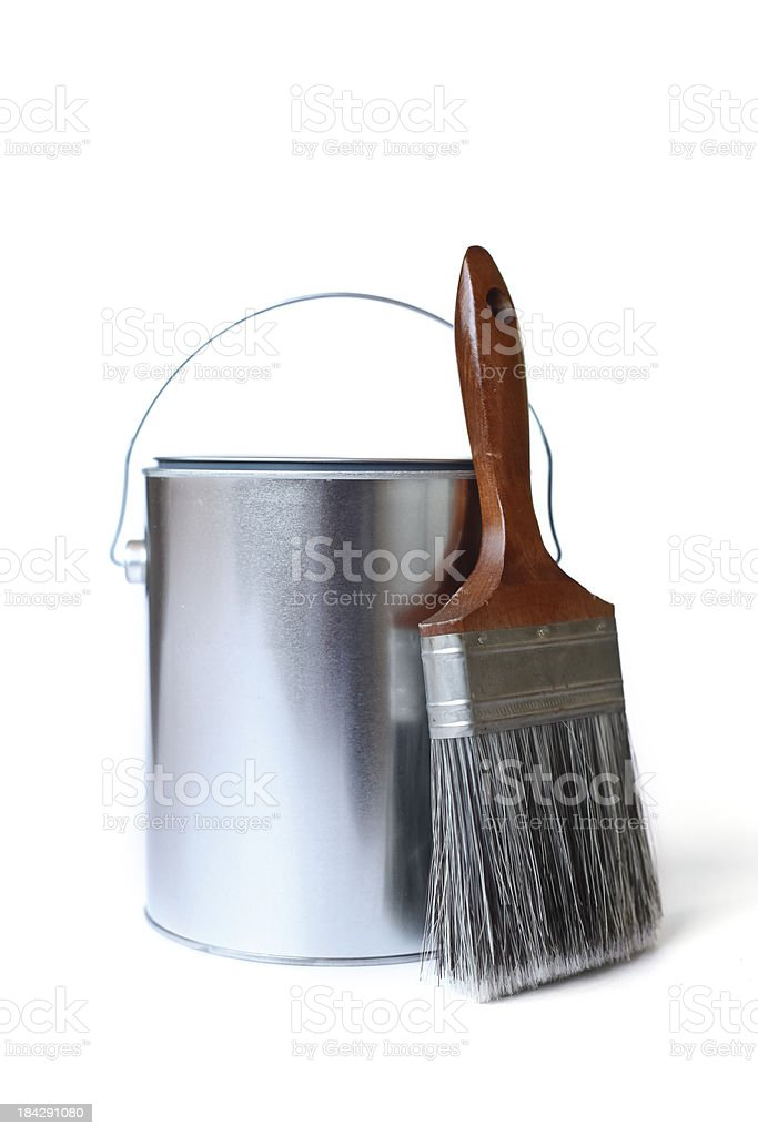 Can of paint with paint brush against white background stock photo