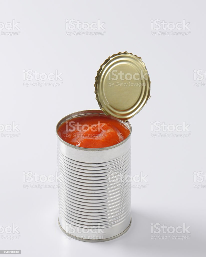can of peeled tomatoes stock photo
