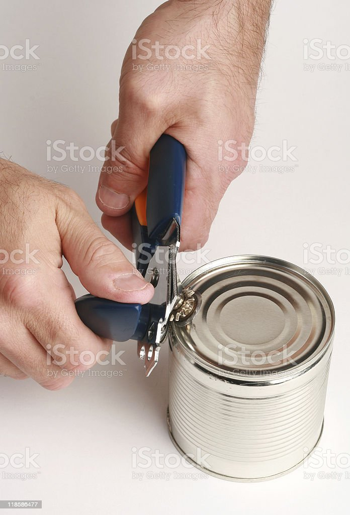 can opener and hands of man stock photo