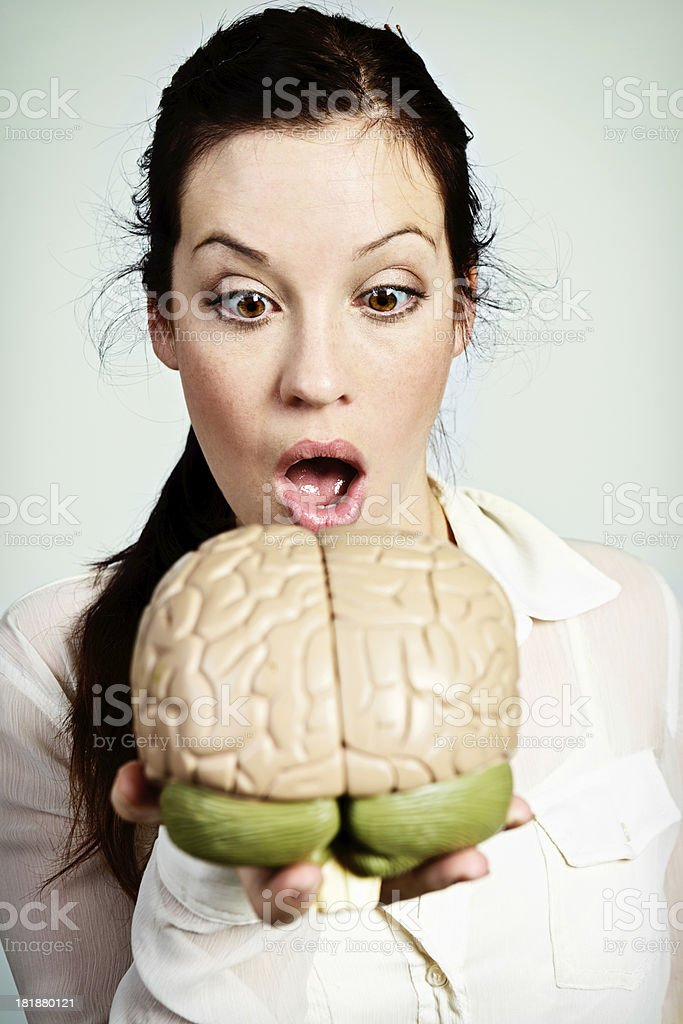 I can read your mind! Woman gasps at model brain royalty-free stock photo