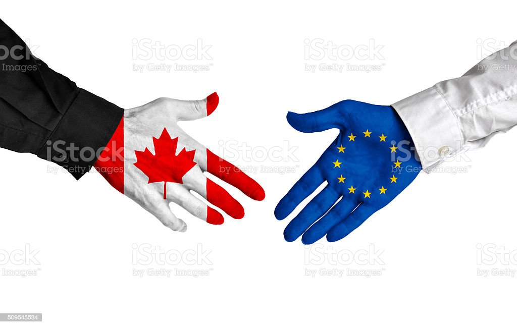 Canada and European Union leaders shaking hands on a deal stock photo