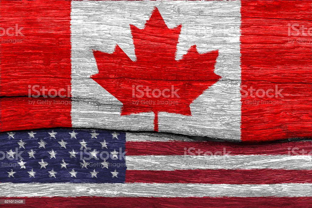 canada and USA flag on wood stock photo