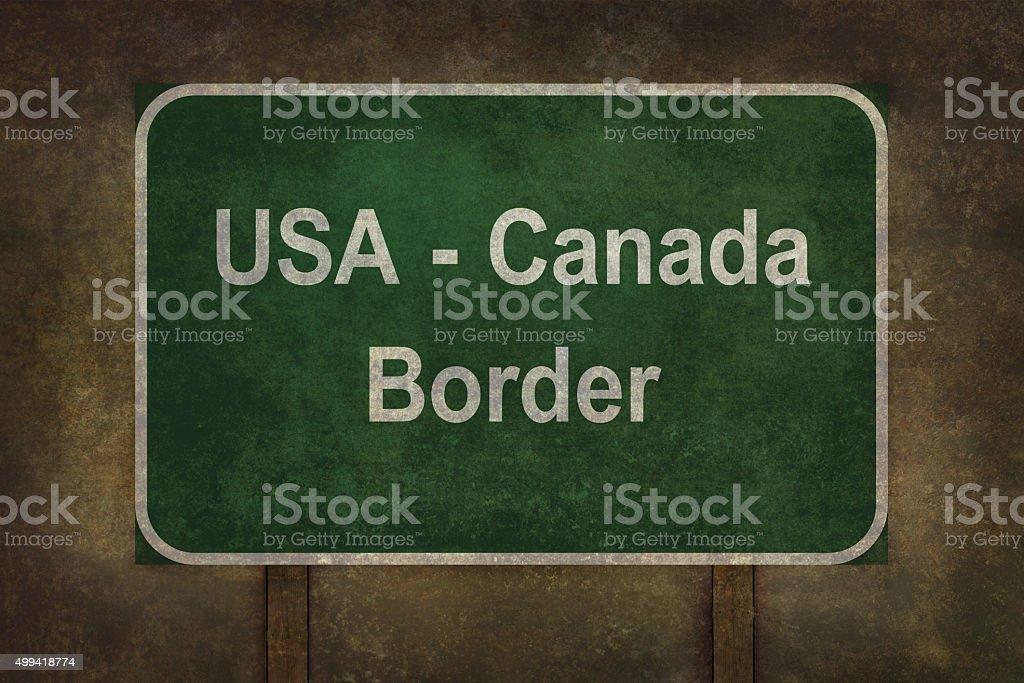 USA - Canada border roadside sign illustration stock photo
