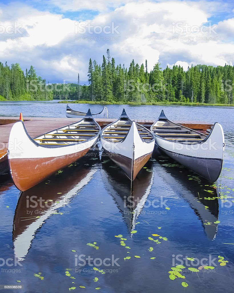 Canada, canoes reflected on a lake stock photo