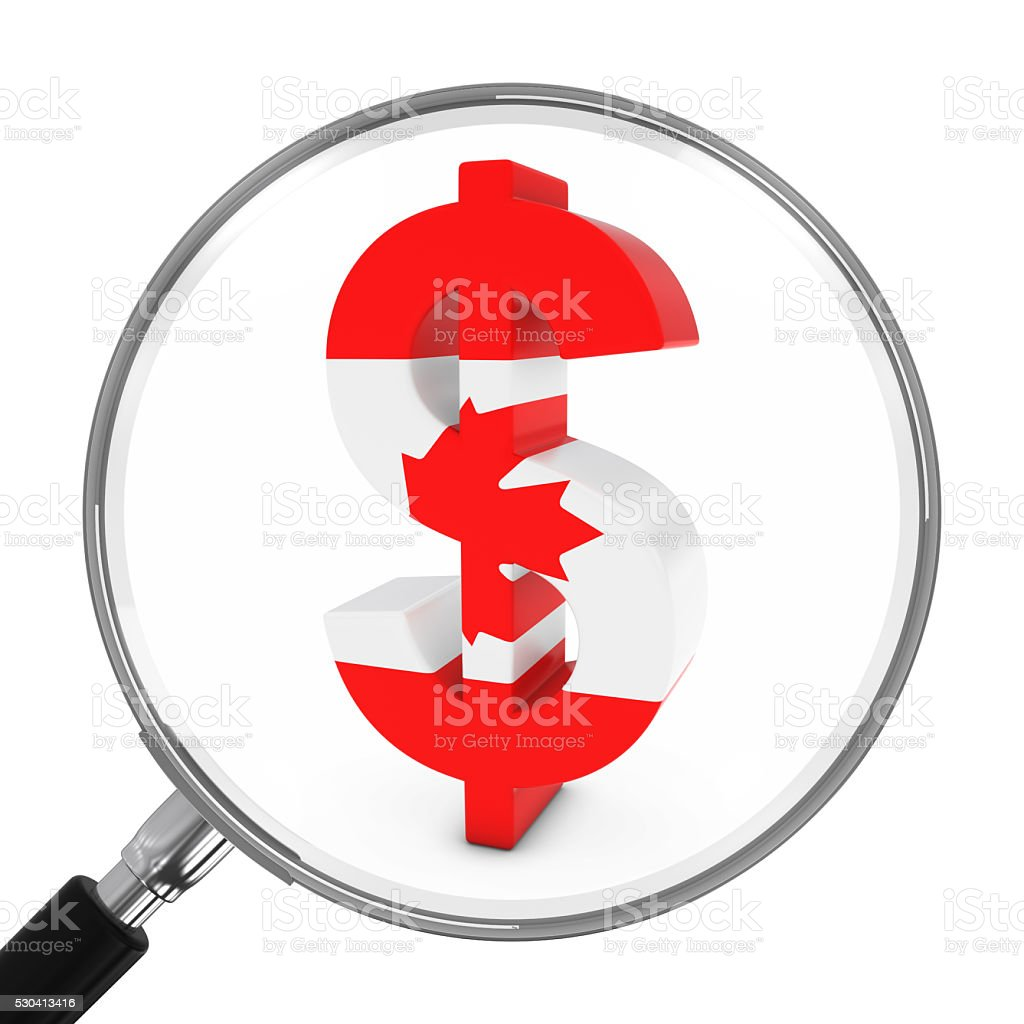 Canada Finance Concept - Canadian Dollar Symbol Under Magnifying Glass stock photo