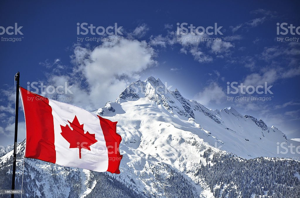 Canada flag and mountain landscape stock photo