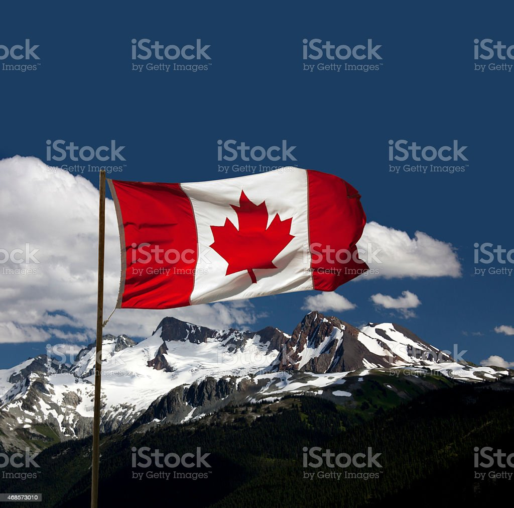 Canada Flag by mountains stock photo