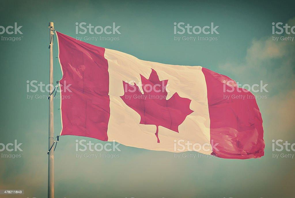 Canada Flag Flying on pole - Retro stock photo