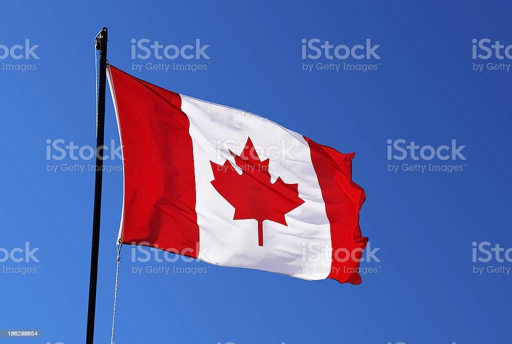 Canada flag on blue sky royalty-free stock photo