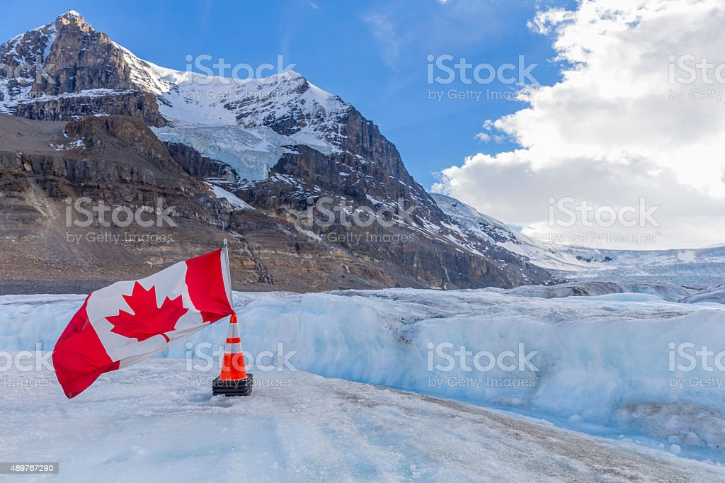 Canada Flag on Columbia Icefield - Athabasca Glacier stock photo