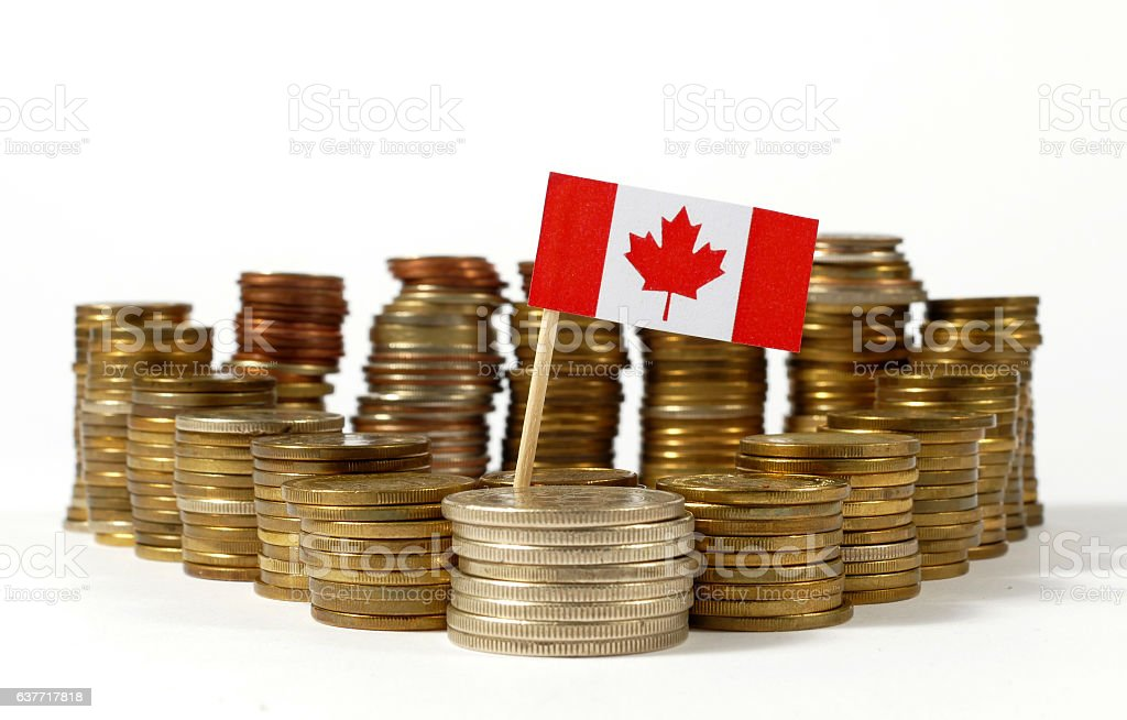 Canada flag waving with stack of money coins stock photo