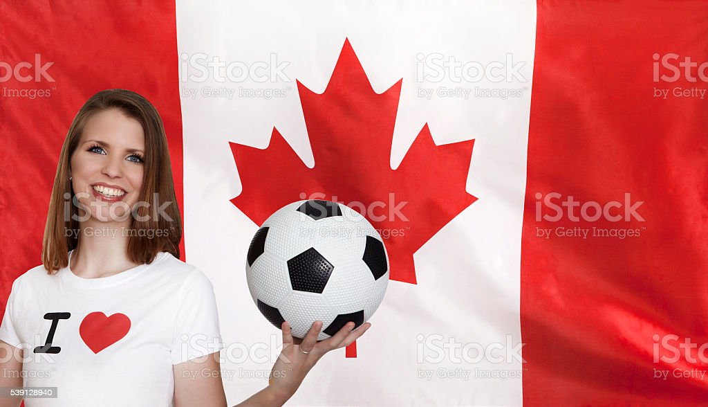 Canada Flag with female soccer fan stock photo