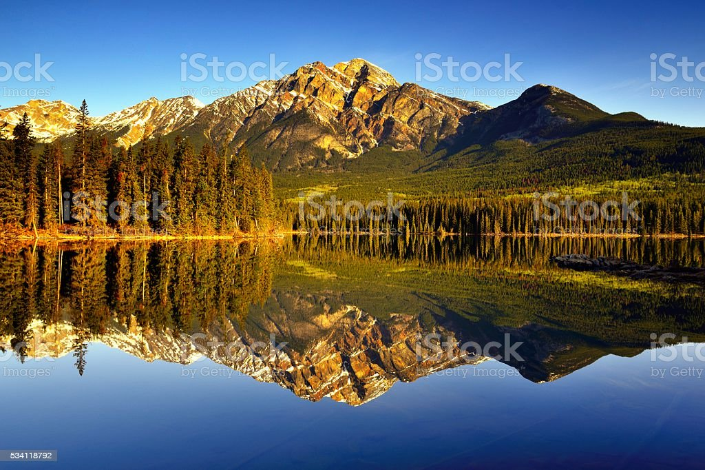 Canada Jasper National Park Pyramid Lake Sunrise Reflection stock photo