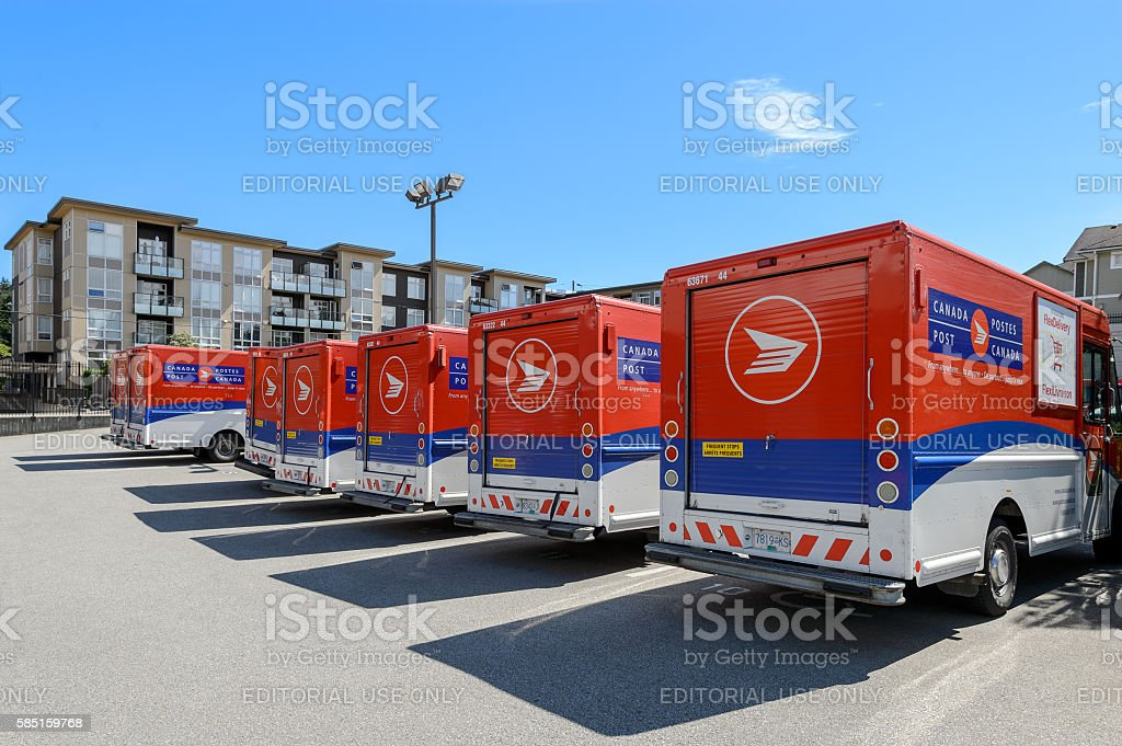 Canada Post trucks on a parking lot. stock photo