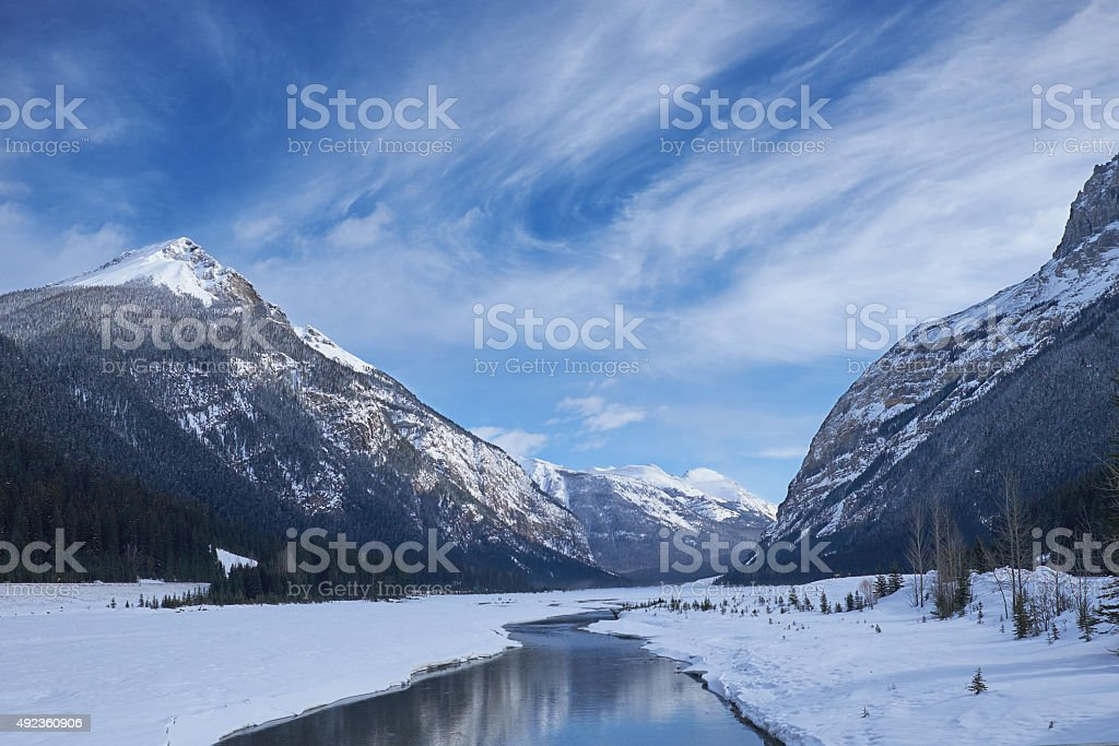 Canada Rocky Mountains with river and reflections stock photo