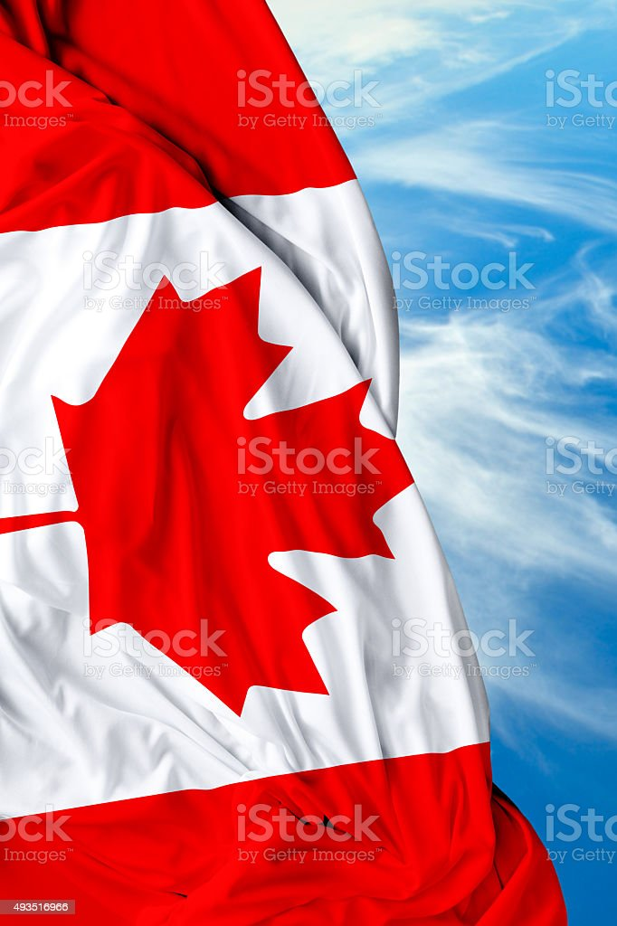 Canada waving flag on beautiful day stock photo