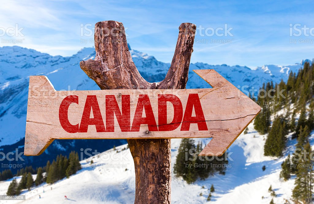 Canada wooden sign with alps background stock photo
