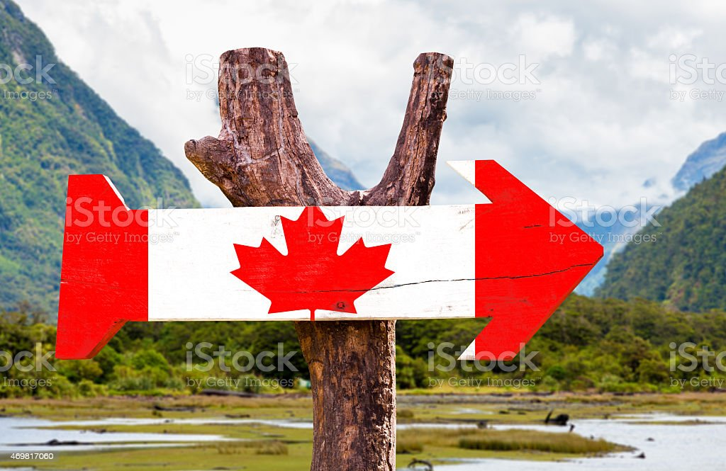 Canada wooden sign with mountains background stock photo