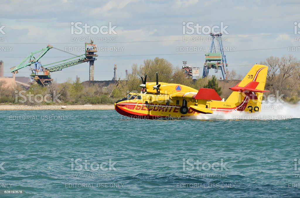 Canadair, water bomber plane in training in the harbor stock photo