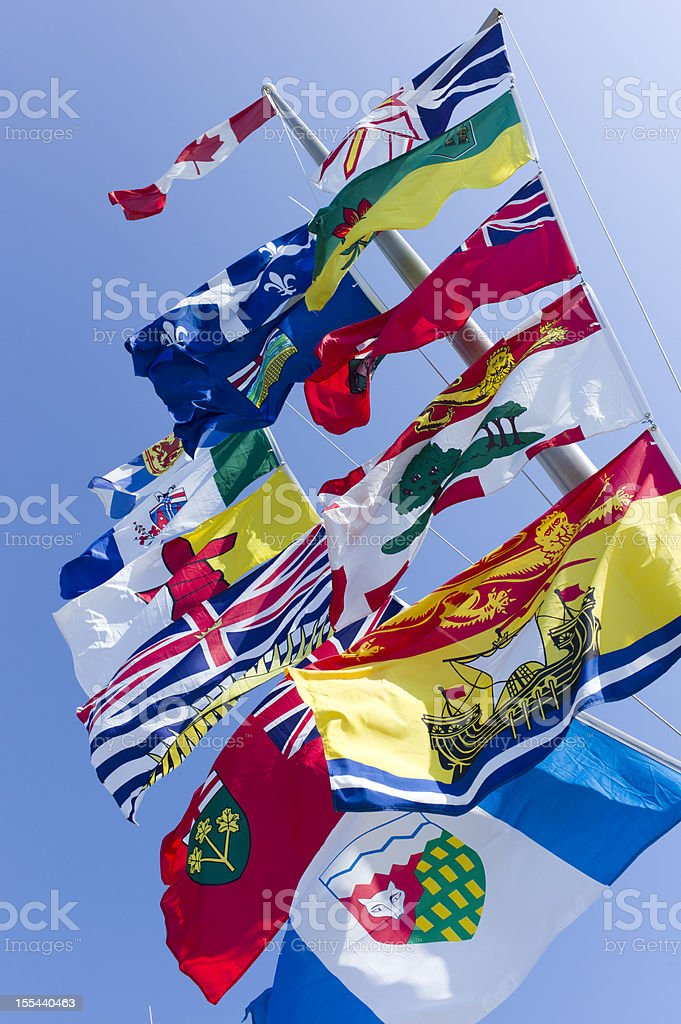 Canada's National, Provincial and Territorial Flags on One Pole. stock photo
