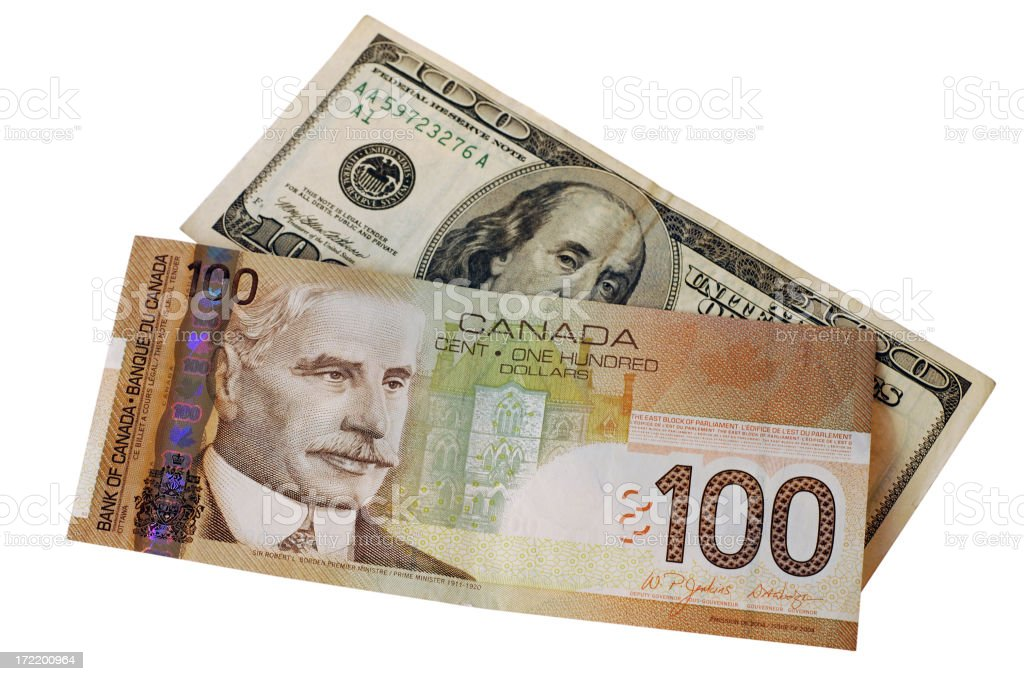Canadian and american 100$ bills stock photo