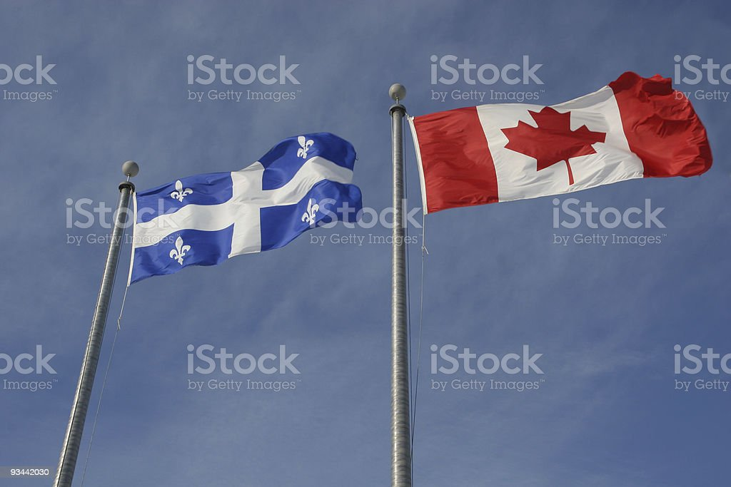Canadian and Quebec provincial flags view from ground royalty-free stock photo