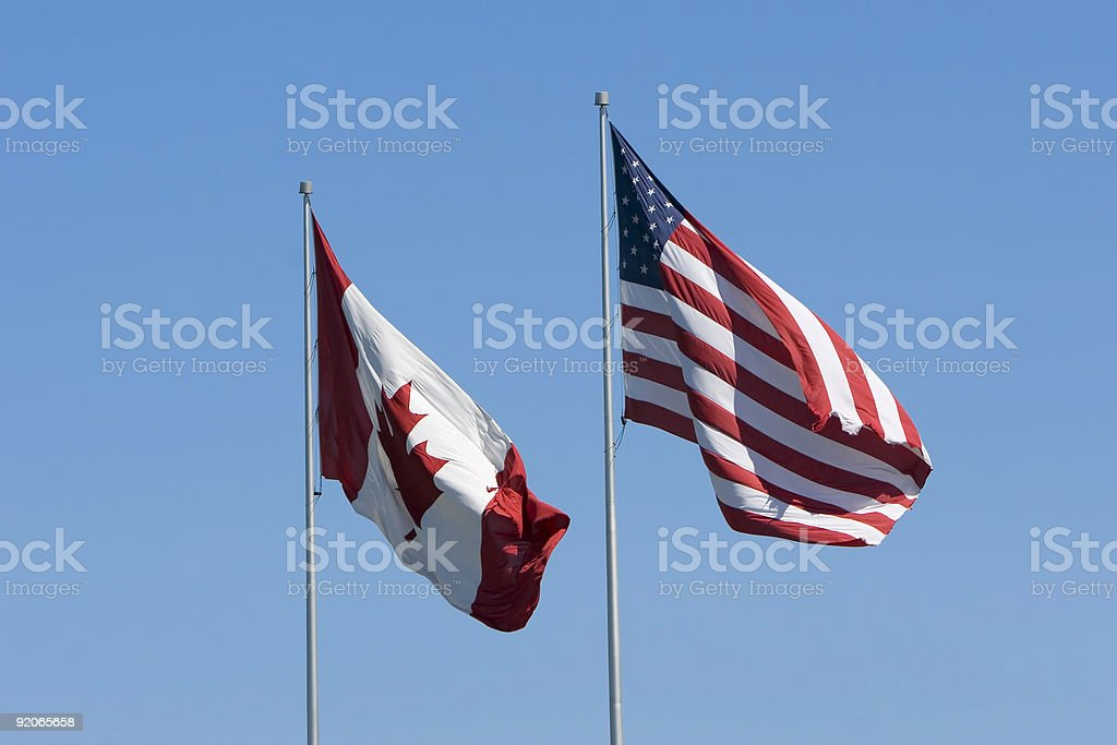 Canadian and US flags stock photo
