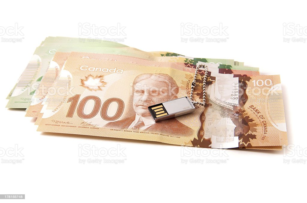 Canadian bank notes with a small USB stick royalty-free stock photo